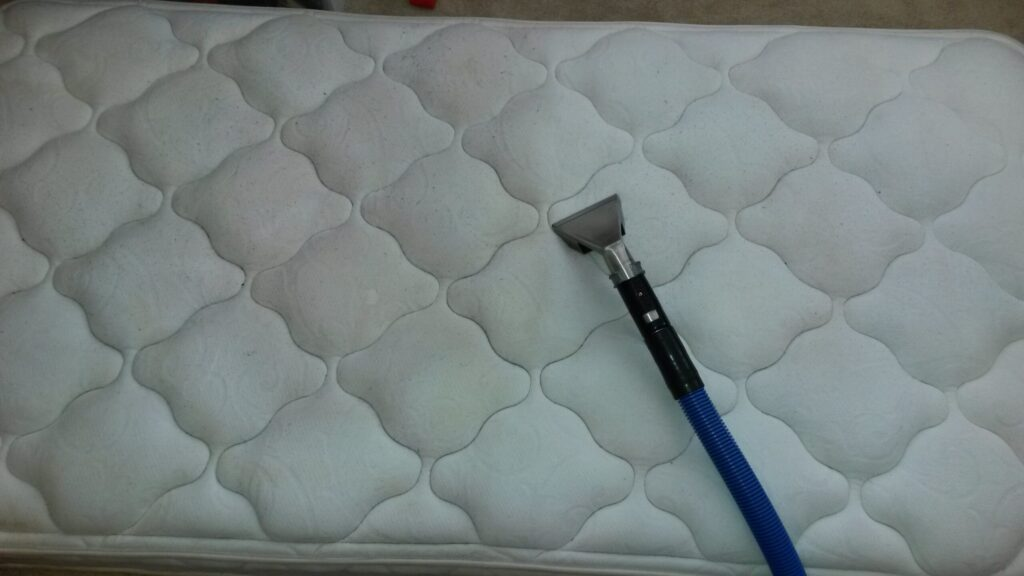 Dirty mattress being cleaned